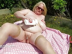 Sally in her bikini in her garden
