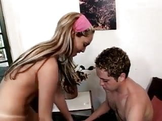 Female doctor introduces male patient to her strap...