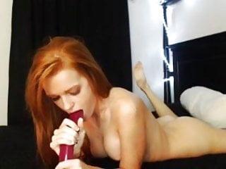 Redhead masturbates big dildo...