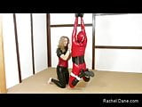 Suspended Rubber Shemale Sex Slave