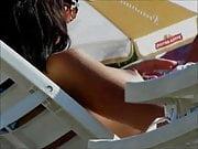 Hidden cam on beach topless brunette
