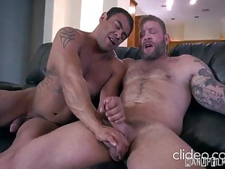 Muscled men Draven N. and Colby J. mutual jagking