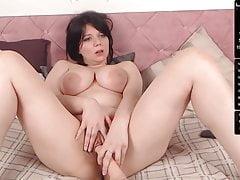 Busty Amy sucks nipples, deepthroats dildo, and masturbates