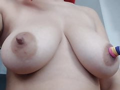 pulling her giant nipples