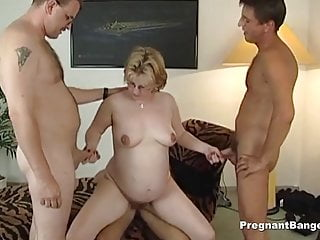 Golden-haired pregnant slut gets gangbang