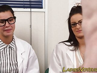 Clothed lady doctors watching