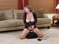 Sexy mature woman riding the sybian