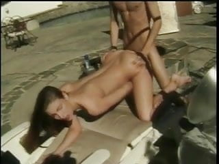 Young flat-chested coed is fucked by dude with ponytail in lounge chair on deck