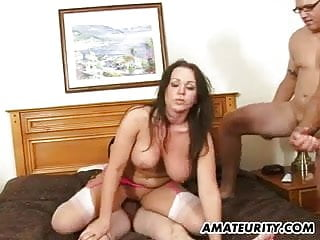 Busty enjoys 4 dicks...