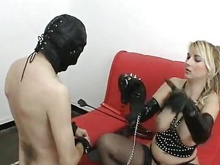Mistress grooming and playing with her slave