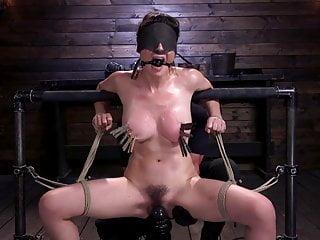 Grueling punishment bondage makes a happy slut...