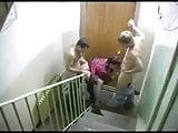 Chubby Russian Milf fucks 2 men in stairs