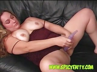 Chubby amateur with big tits playing with purple toy