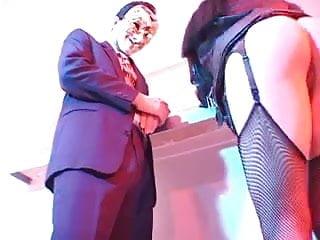 Guys in mask boning girls rear end