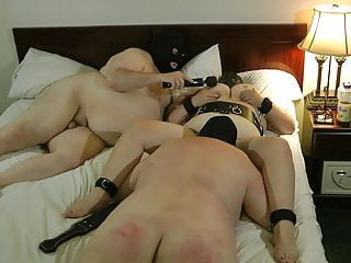 male slave eating female slave while Master plays her udders