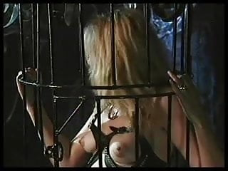 Caged wench is a dungeon slut