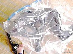 Cute Latex girl on vacuum bag and mask, breathplay