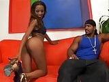 Black sex on red sofa