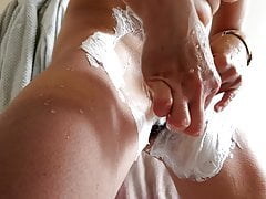 My wife is shaving her hairy pussy after shower in close up
