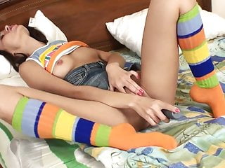 Horny brunette babe shoves a dildo in her girlfriend's cunt