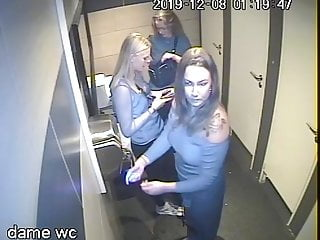 Security cam in the disco at night, women's bathroom