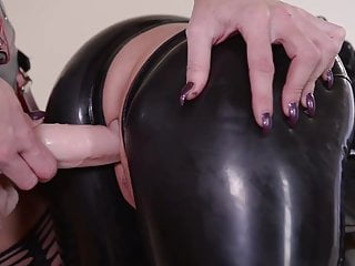 LATEX SLAVE CHASTISED BY DOMINA, PART TWO