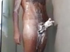 Hairy guy is soaping himself in the shower