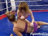 Redhead lesbian fingering her opponent