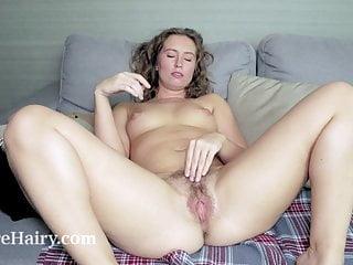 Nikky B has enjoyable with stockings on her sofa