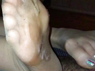 Slowly draining his balls together with her nylon stockinged toes