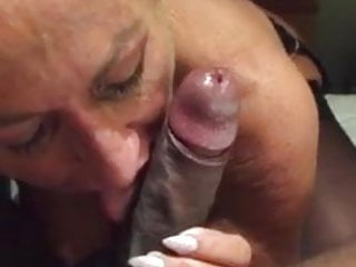 Slut loving black dick in her mouth...
