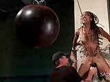 Hot young slut in brutal bondage suffering.