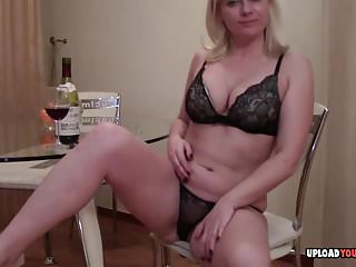 Blonde with wine bottle...