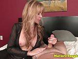 Seductive MILF sensually stroking cock POV