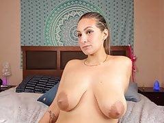 Busty Latina sprays milk from her big brown nipples