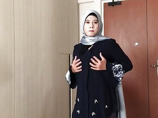 In hijab touches self...