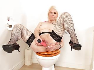 English milf Skyler fingers her fanny on rest room