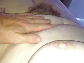 rubbing her tit, soft belly & hairy pussy.