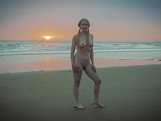 Nude At Deserted Stormy Beach